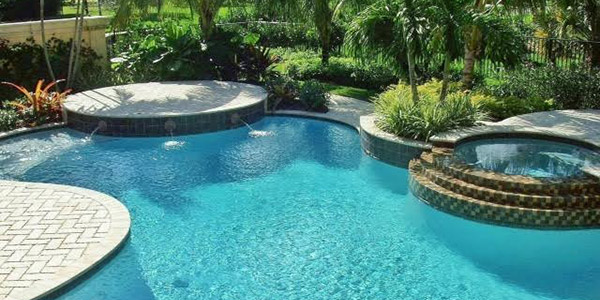 A swimming pool with nice landscaping around